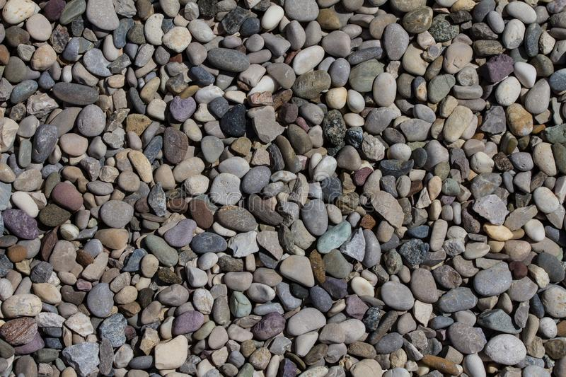 Colorful background with stones pattern at a beach royalty free stock photos