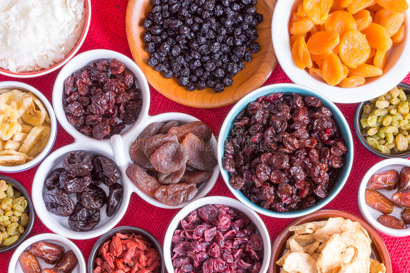 Colorful background of a variety of dried fruits stock photos