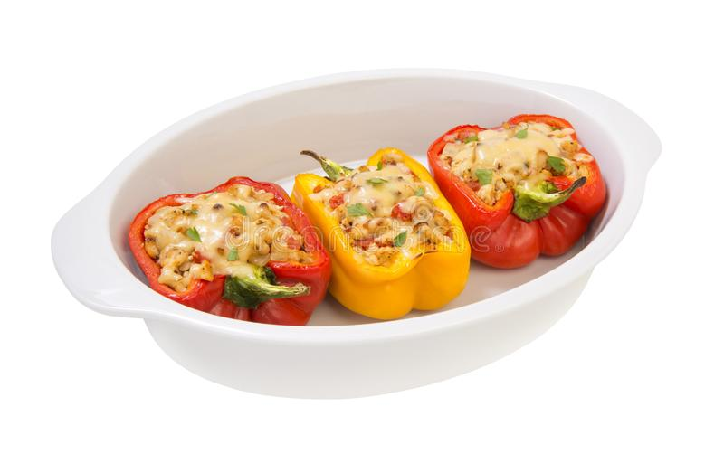 Baked with cheese, stuffed peppers with minced turkey and vegetables isolated on a white backgroundё. Colorful baked with cheese stuffed peppers with minced stock images