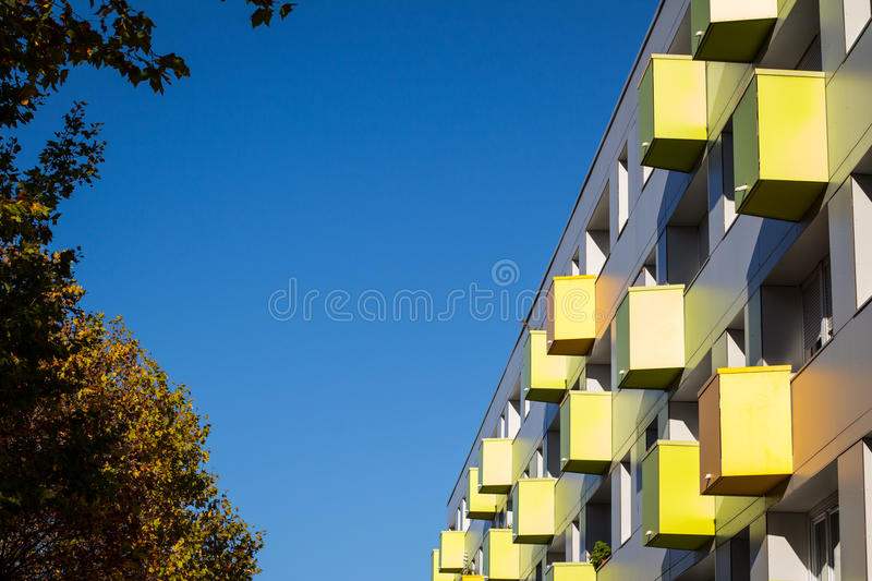 Colorful balconies on apartment building. In the autumn stock photos