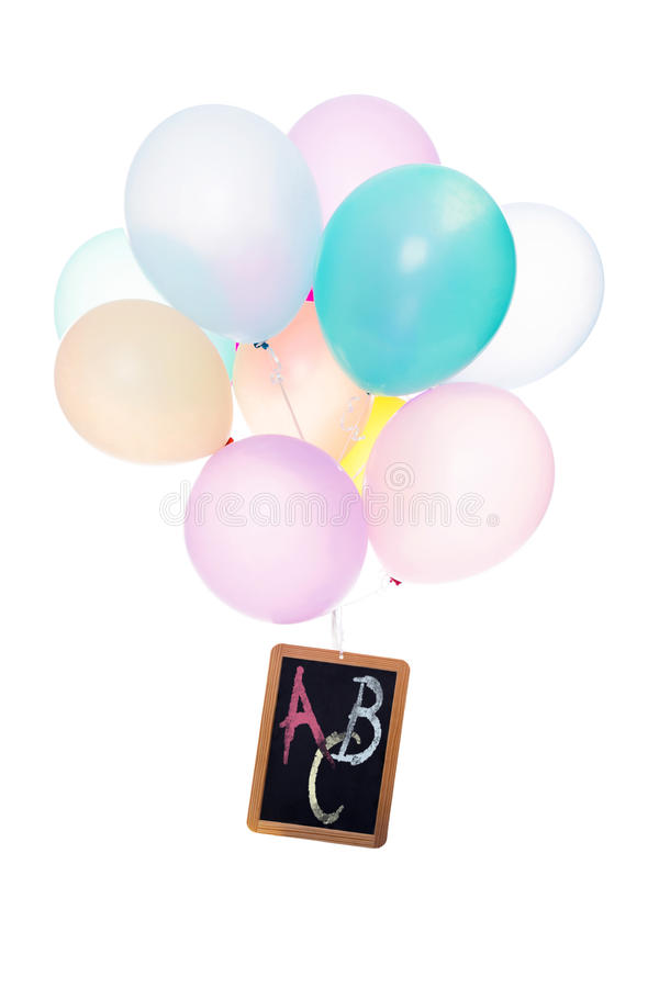 Colorful ballons, slate with Letters ABC royalty free stock photo