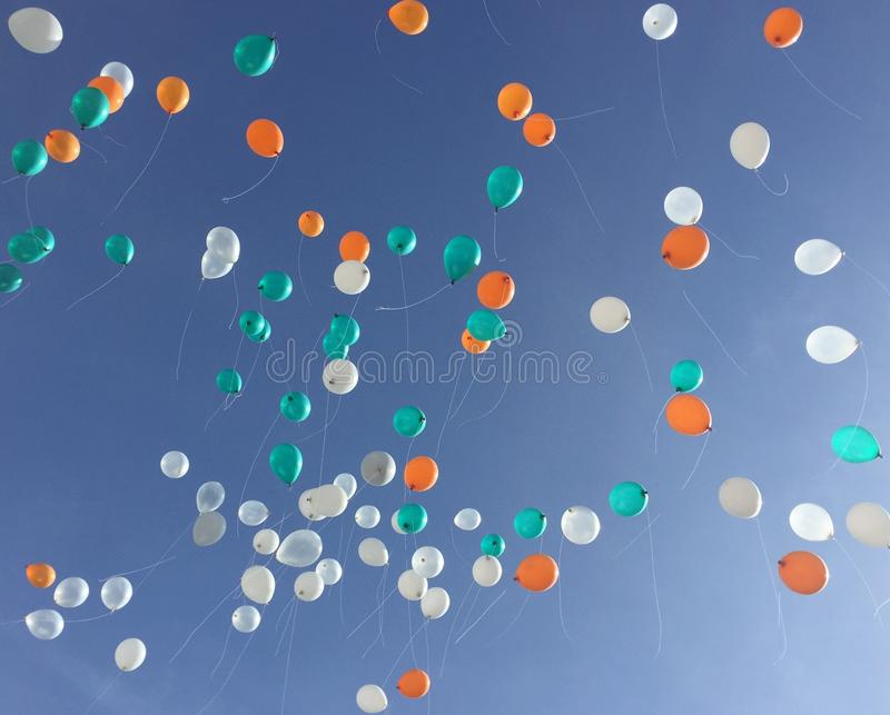 Colorful balloon float up to the blue sky. stock photography