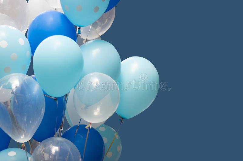 Colorful balloons on blue background. happy new year and happy birthday concept stock photography