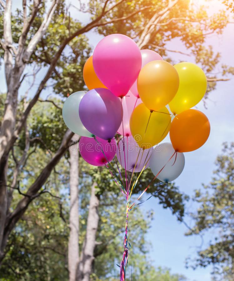 Colorful balloons on the blue sky stock photography