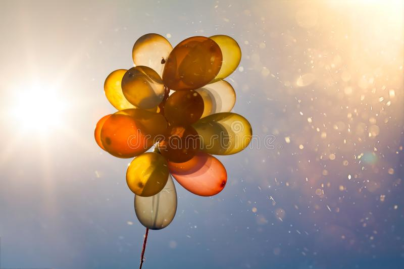 Multicolored balloons flying royalty free stock photo