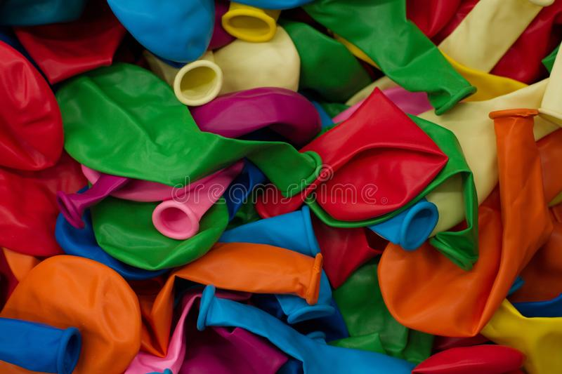 Colorful balloons and confetti on blue table top view. Festive or party background. Flat lay style. Copy space for text. Birthday royalty free stock photo