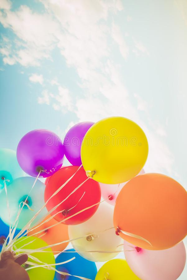 Colorful balloons done with a retro instagram filter effect. Concept of happy birth day in summer and wedding, honeymoon party use for background. Vintage stock photo