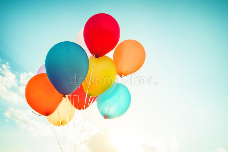Colorful balloons done with a retro instagram filter effect. Concept of happy birth day in summer and wedding, honeymoon party use for background. Vintage stock images