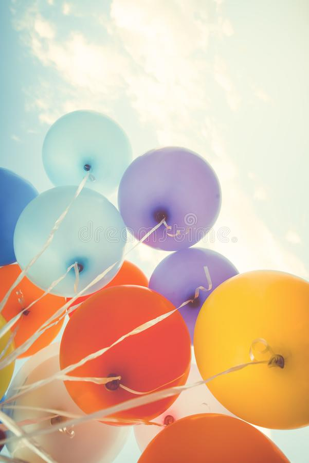 Colorful balloons done with a retro instagram filter effect. Concept of happy birth day in summer and wedding, honeymoon party use for background. Vintage royalty free stock images