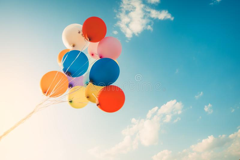 Colorful balloons done with a retro instagram filter effect. Concept of happy birth day in summer and wedding, honeymoon party use for background. Vintage stock photography
