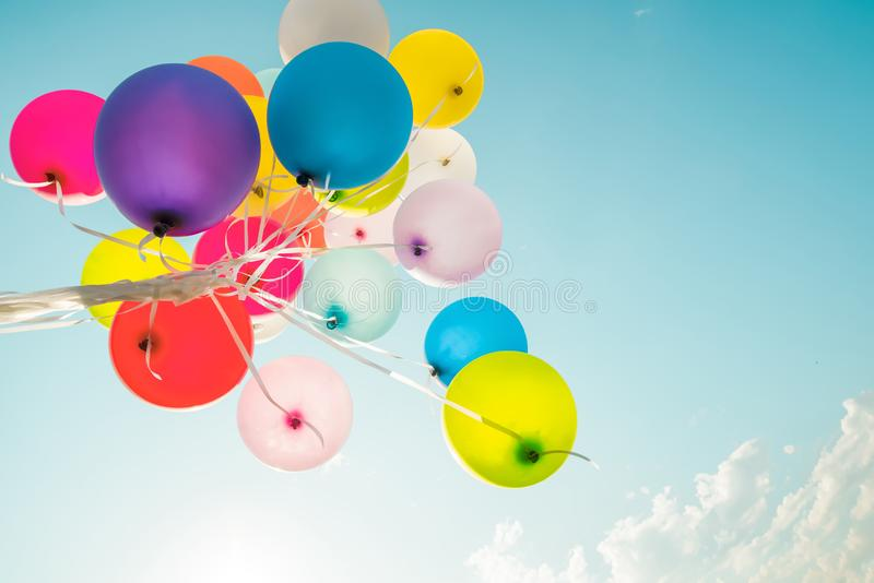 Colorful balloons done with a retro instagram filter effect. Concept of happy birth day in summer and wedding, honeymoon party use for background. Vintage royalty free stock image