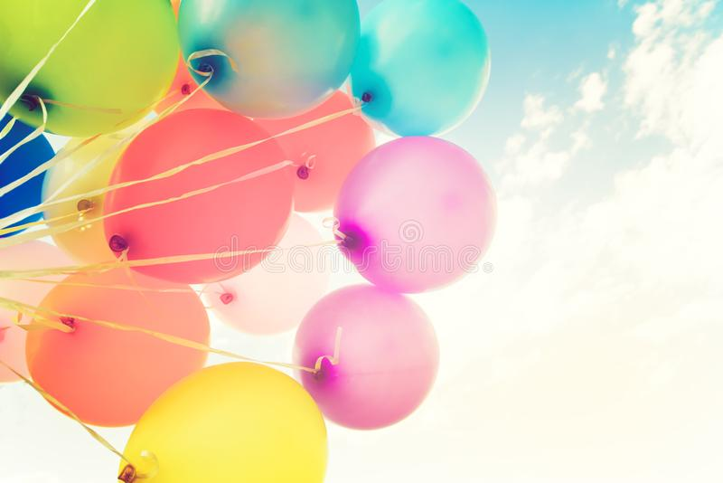 Colorful balloons done with a retro instagram filter effect. Concept of happy birth day in summer and wedding, honeymoon party use for background. Vintage royalty free stock photos