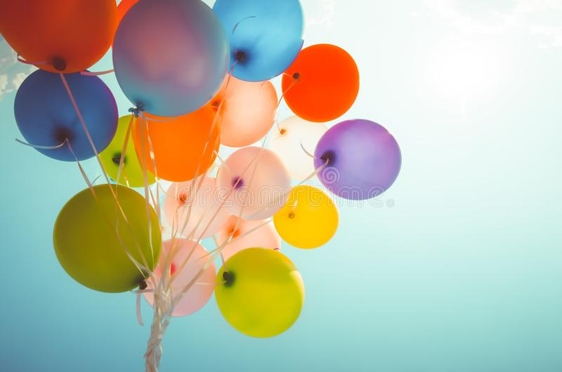 Colorful balloons done with a retro instagram filter effect. Concept of happy birth day in summer and wedding, honeymoon party use for background. Vintage royalty free stock photo