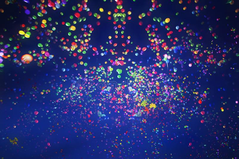 Colorful balloons flying into the blue sky at night. Holiday, festival and party background royalty free stock image