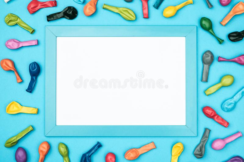 Colorful balloons and frame on colorful background top view. Birthday or party mockup royalty free stock photos