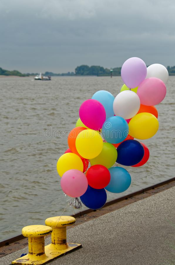 Colorful balloons on quay in Hamburg Blankenese. Colorful balloons on quay near so-called Treppenviertel lit. stairs quarter in Hamburg Blankenese, Germany royalty free stock photography