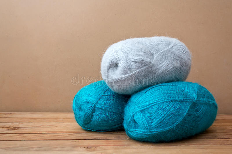 Colorful balls of knitting yarn. Balls of wool on wooden background royalty free stock photo