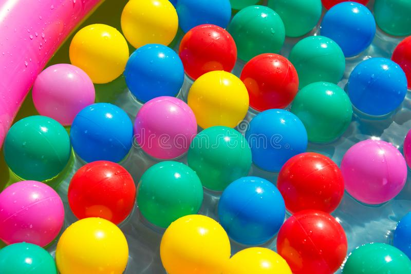 Colourful balls in the swimming pool, summer concept stock image
