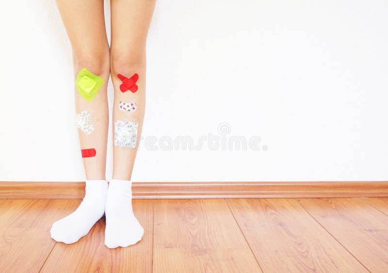 Colorful bandages on childs leg royalty free stock photos