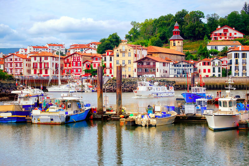 Colorful basque houses in port of Saint-Jean-de-Luz, France. Traditional half-timbered basque houses in port of St Jean de Luz, on the atlantic coast of France stock photography