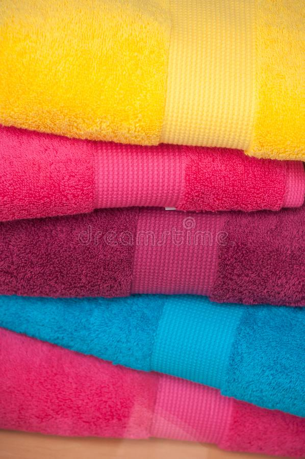 Colorful bath towels pile in store royalty free stock photo