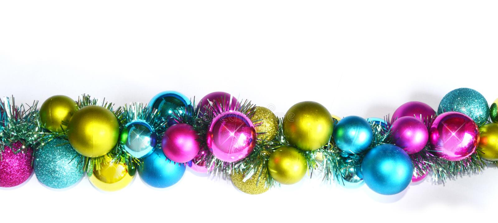 Colorful baubles and tinsel stock image