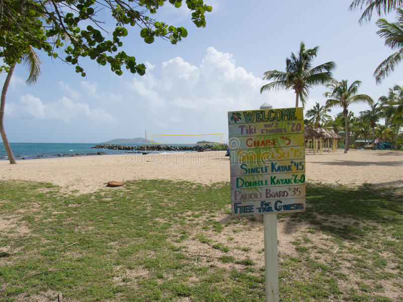 Colorful Beach Activities Price List. At a Resort with the Beach and Ocean in the Background in St. Croix, U.S. Virgin Islands stock photo