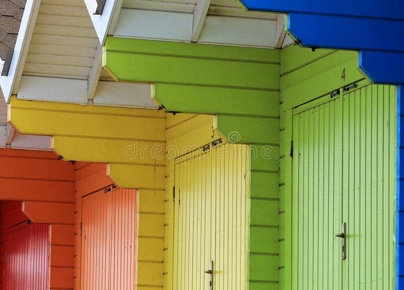 Colorful beach chalets. Row of colorful wooden beach chalets stock photos