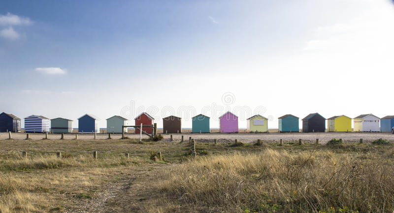 Colorful Beach Huts on a Sunny Day royalty free stock image