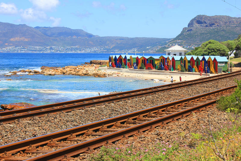 Colorful beach nuts, Muizenberg, Cape Town, South Africa. Colorful beach nuts with train trail, Muizenberg, Cape Town, South Africa royalty free stock image