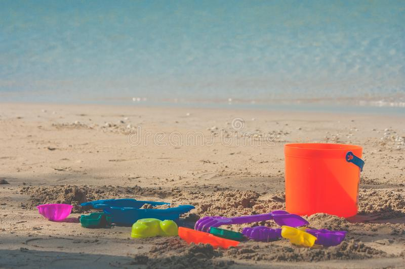 Colorful beach toys or children toys on sand beach with seascape view in the background. stock image