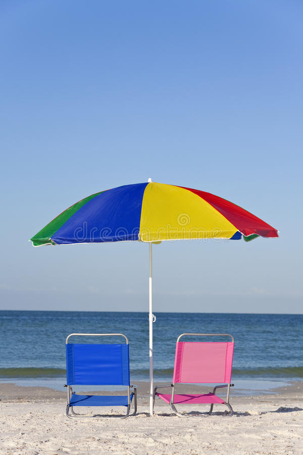 Colorful Beach Umbrella, Pink & Blue Deckchairs Stock Image