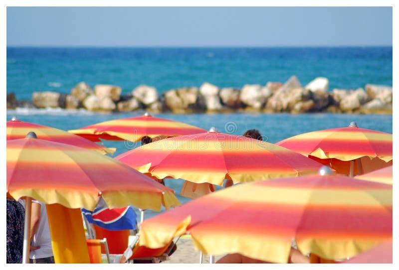 Beach Umbrellas And People On Playa El Emir In Summer