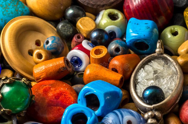 Colorful beads, buttons, pearls and other decorative items royalty free stock photos