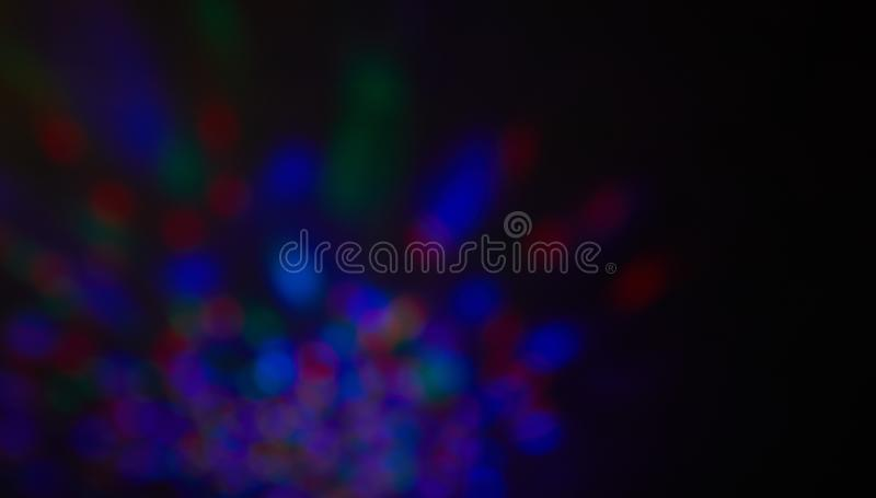 Colorful beautiful blurred bokeh background with copy space.multicolored light spots on dark background, defocused royalty free stock photography