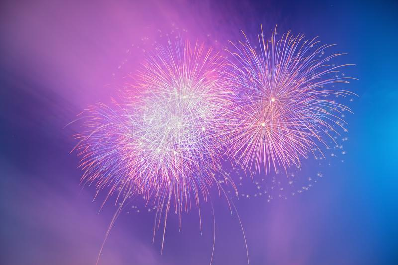 Colorful beautiful fireworks salute against the blue sky royalty free stock image