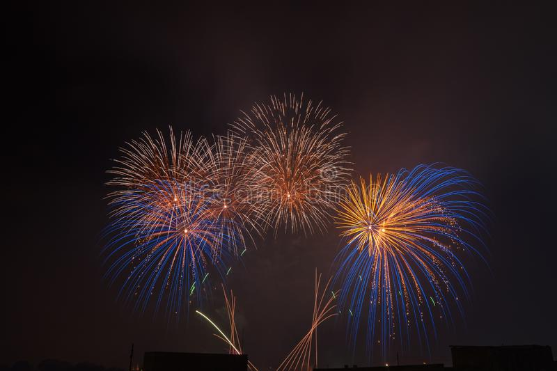 Colorful beautiful fireworks salute against the dark night sky. stock images