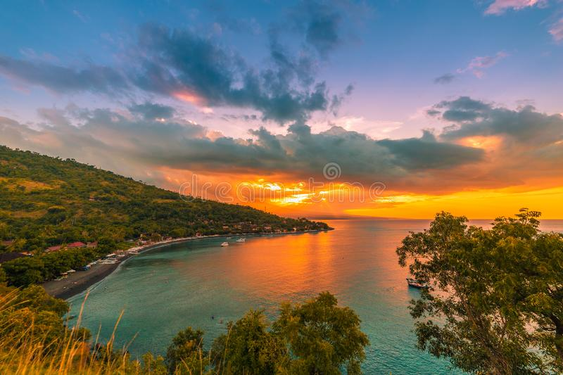 Colorful beautiful sunset in tropical Jemeluk bay on Amed, Bali, Indonesia royalty free stock photography