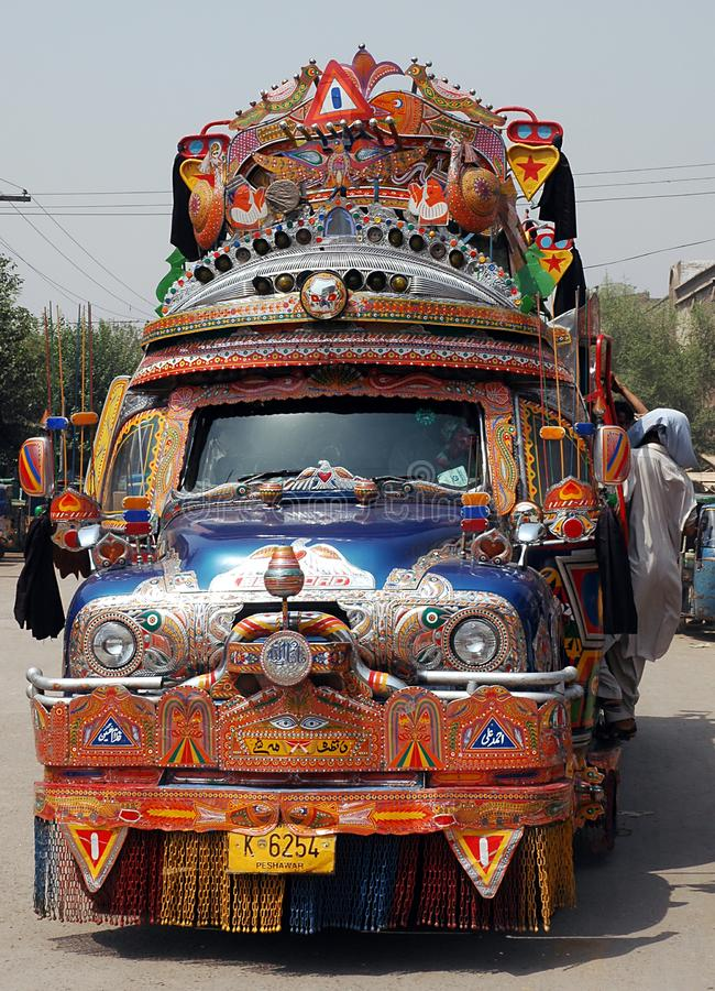 A colorful Bedford truck used as bus in Peshawar, Pakistan. Colorful Bedford truck used as local transportation in Peshawar, Pakistan. The truck is colourful and royalty free stock image