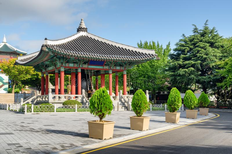 Colorful bell pavilion of traditional Korean architecture. On blue sky background at Yongdusan Park in Busan, South Korea. Scenic sunny cityscape. Busan is a stock photography