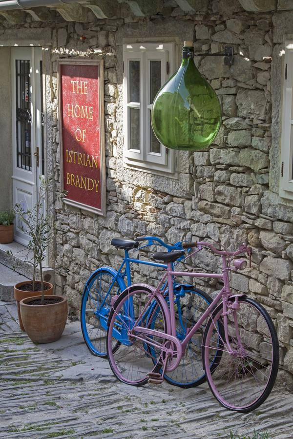 Stillife with colorful bicycles. Colorful painted ladies` and men`s bicycle stock photos