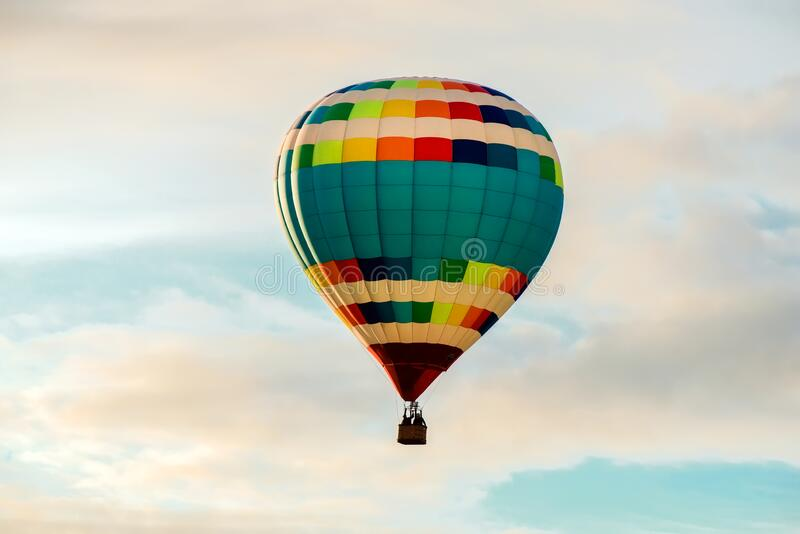 Colorful big hot air balloon flying stock photography