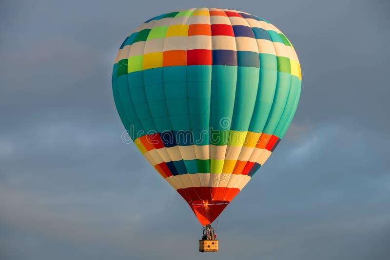 Colorful big hot air balloon flying stock photos