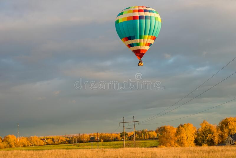 Big hot air  Balloon Over Power Line stock images
