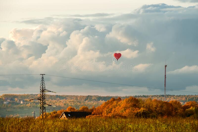 Red heart in the clouds stock photo