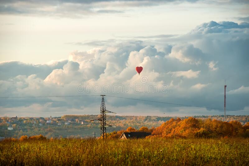 Aerial landscape with clouds and a balloon royalty free stock photos