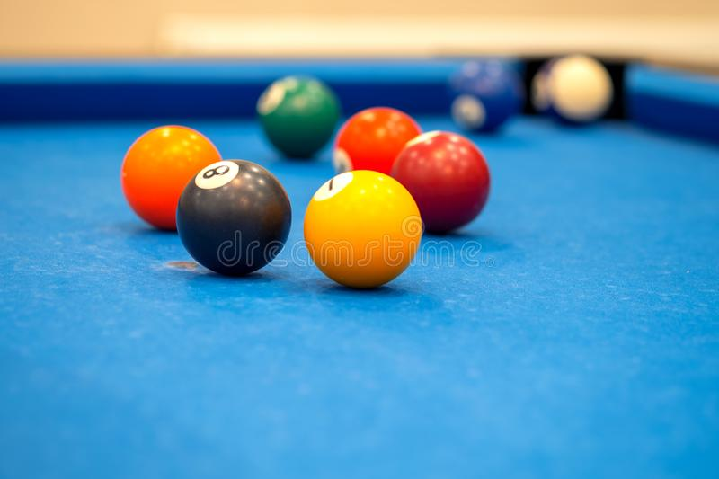 Colorful billiard balls on blue table, billiards game royalty free stock photos