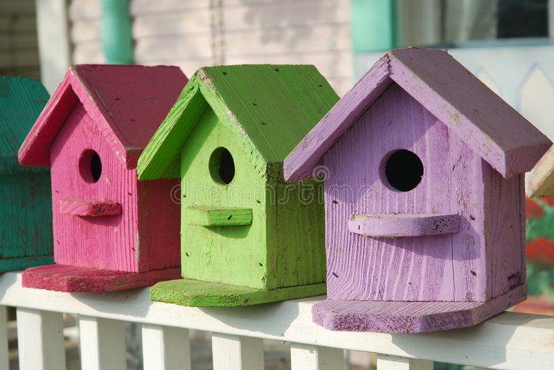 Colorful Birdhouses. Hand crafted birdhouses are painted with pastel colors stock images