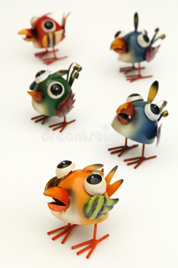 Colorful birds. Bunch of colorful toy birds isolated on a white background stock photos