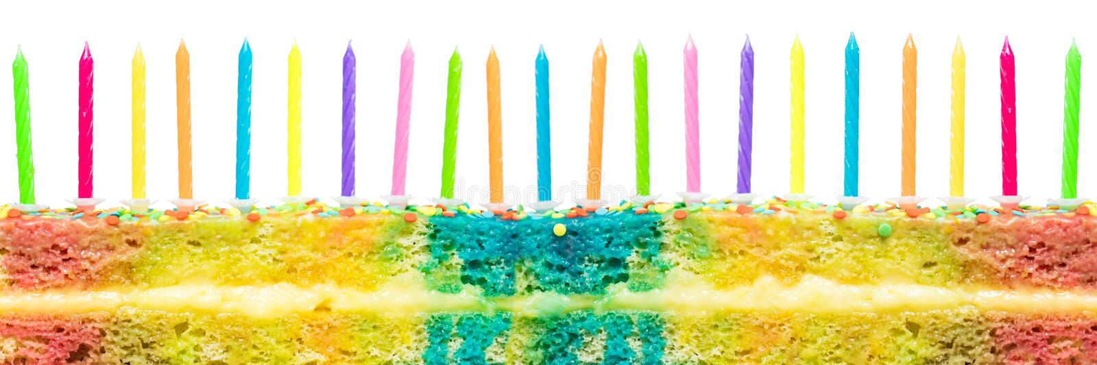 Birthday cake. Colorful birthday cake with lot of many coloured candles on it. Isolated on white background royalty free stock photography